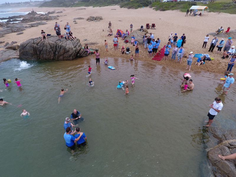 Candidates being baptised in the Southport tidal pool