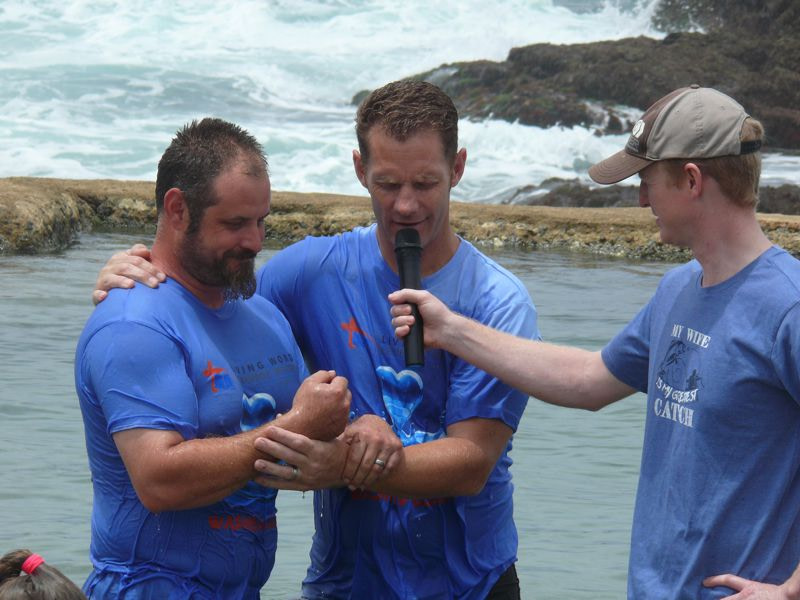 Pastor praying before baptising the candidate