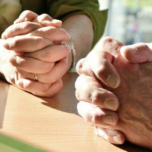 Hands folded together in prayer