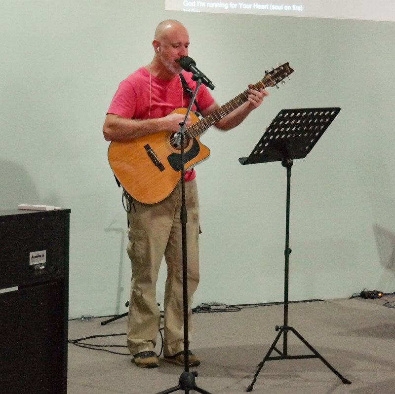 Edward Holden Smith singing and player guitar