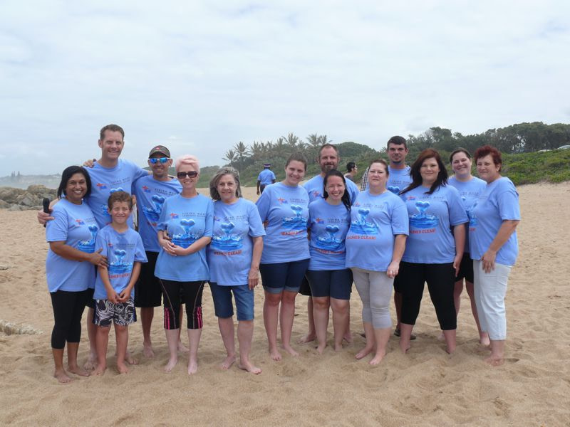 A group of baptism candidates in their blue t-shirts.